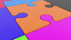 Colorful puzzle pieces on white Stock Footage