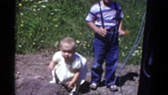 1959: children playing and falling CATSKILL GAME FARM, NEW YORK Stock Footage