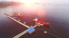 Oil Tanker at refinery plant in Indonesia at the sun set Stock Footage