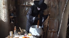 Halloween witch preparing potion in the boiler Stock Footage