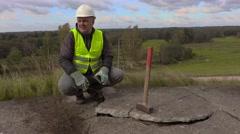 Angry worker talking near broken concrete slabs Stock Footage