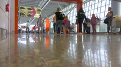 Warsaw Chopin airport terminal hallway with travellers, tourists Stock Footage