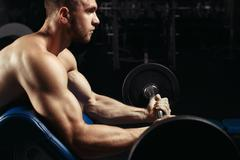 Bodybuilder in the gym Stock Photos
