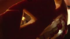 Halloween pumpkin Jack O' Lantern lamp with vampire bloody fangs Stock Footage