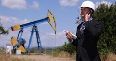 Pumpjack Report Young Businessman Talking Oil Pump Plans Cellphone Communication Stock Footage