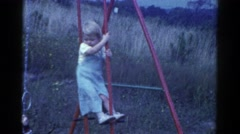 1959: kids playing on a swingset CATSKILL GAME FARM, NEW YORK Stock Footage