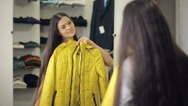 Woman trying on clothes Stock Footage