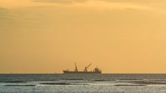 4K Time laspse of cargo ship with crane with sunset sky Stock Footage