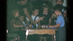 1959: an indoor family party is seen CATSKILL GAME FARM, NEW YORK Stock Footage