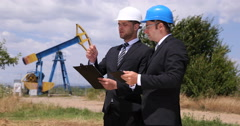 Successful Businessman Team Chatting Oil Pump Extracting Technology Presentation Stock Footage