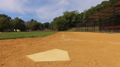 Looking Down First Base Line of Youth Baseball Field Stock Footage
