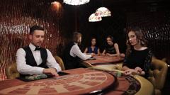 Elegant luxury girl in black dress playing blackjack in casino Stock Footage