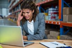 Business woman is stressed because of work in a warehouse Stock Photos