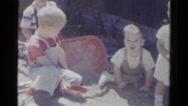 1959: children are seen having fun in a garden area CATSKILL GAME FARM, NEW YORK Stock Footage