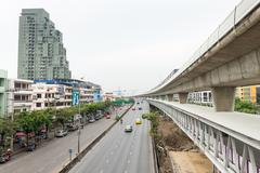 BANGKOK, THAILAND - 12 APR 2013: Elevated Skytrain rail system with Skypass p Stock Photos