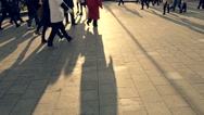 People go on a city street in sunset Stock Footage