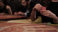Woman in Black Dress Takes the Card and Makes a Bet in a Casino, Blakjack Stock Footage