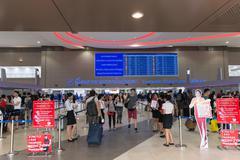 BANGKOK, THAILAND - 9 FEB 2016: Passengers strolling between ticketing counte Stock Photos