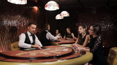 Two Beautiful Women Playing at the Table Blackjack in a Casino Stock Footage
