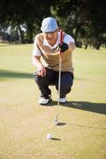 Sportsman analysing the field on a golf course Stock Photos