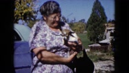 1960: grandma holding her most prized possession, her chihuahua WAUCONDA Stock Footage