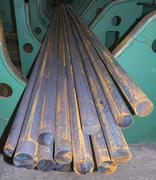Steel round bars in factory storehouse Kuvituskuvat