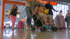 Family traveling, transit in Warsaw Chopin airport - walking with suitcases Stock Footage
