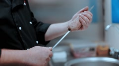Chef stringing meat on a skewer Stock Footage