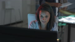4K Young technology startup company, woman watching computer screens Stock Footage