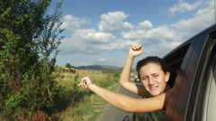 Girl Play Dancing and Singing Leaning out of Car Window, Family Traveling on Stock Footage