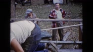 1960: dude oversees a project being done by his employees and enjoys a cold beer Stock Footage