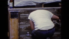 1960: man kneels on staircase while smoothing cement steps with trowel WAUCONDA Stock Footage