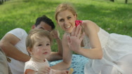 CLOSE UP, DOF: Pretty mum, happy dad and cheerful baby saying hi and waving Stock Footage