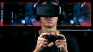 Virtual reality game. Man with pleasure uses head-mounted display. Stock Footage