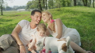 SLOW MOTION: Adorable Jack Russell pet dog stealing cookies from sweet baby girl Stock Footage