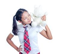 Schoolgirl holding a teddy bear Stock Photos