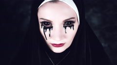 4k Halloween Shot of a Horror Nun with Black liquid Pouring from Eyes Stock Footage