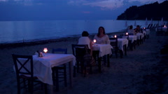 A restaurant near a beach at night in Greece Stock Footage