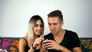 Portrait of a young couple using smartphone Stock Footage