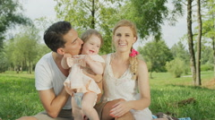 CLOSE UP: Joyful young father tossing his smiling baby girl up and down Stock Footage