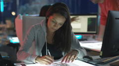 4K Portrait smiling young computer game designer drawing at her desk Stock Footage