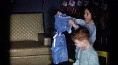 1959: children unwrapping their presents on christmas morning CATSKILL GAME Stock Footage