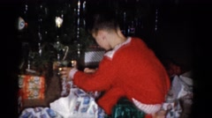 1959: child unwrapping holiday presents CATSKILL GAME FARM, NEW YORK Stock Footage