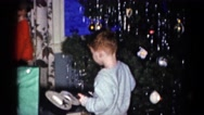 1959: a christmas tree is seen with a child opening presents CATSKILL GAME FARM Stock Footage