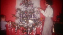 Brother & sister decorating the Christmas tree 3649 vintage film home movie Stock Footage