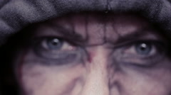 Mad eyes of an evil man. Dirty face in blood. head in the hood Stock Footage
