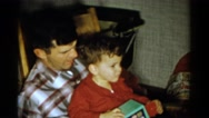 1959: parent and child spending quality time together, bonding over a toy Stock Footage