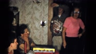 1959: lady in pink looking around room full of people CATSKILL GAME FARM Stock Footage