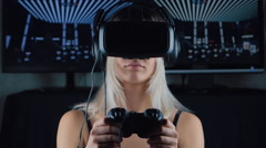 Woman plays virtual reality game using head mounted display Stock Footage