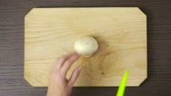 Woman cutting a mushrooms on a wooden table. champignon Stock Footage